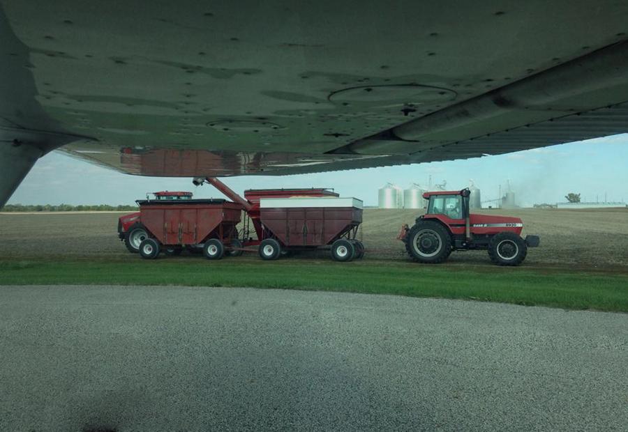 Aviation, tractor in field 900x620