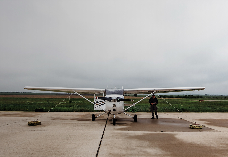 Aviation, Single engine airplane docked on a cloudy day 900x620