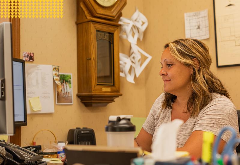 Clerk-Treasurer, Utility clerk Andrea Standish working on computer