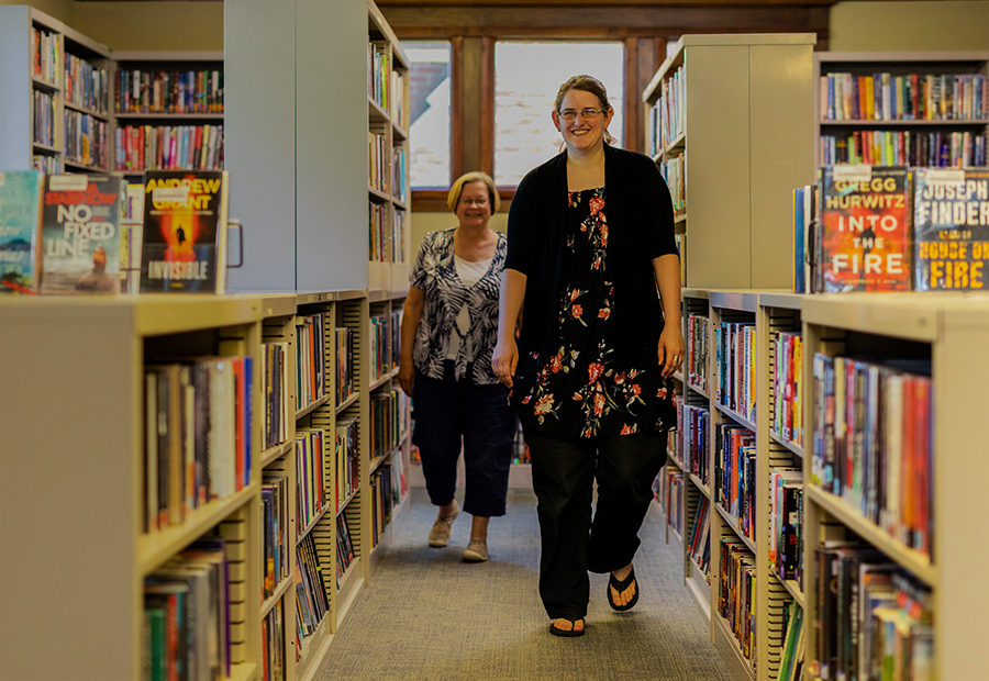 Kentland Public Library, Two Smiling Librarians Walking Down Aisle