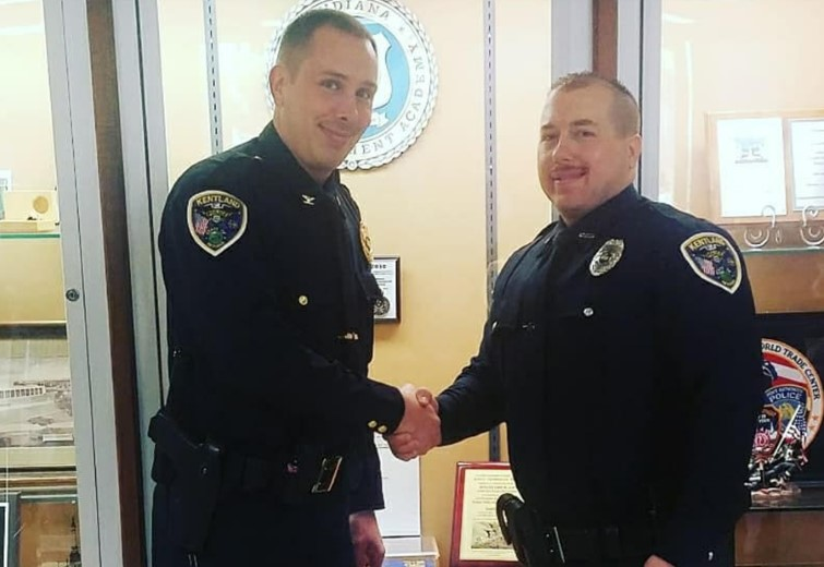 Two Kentland officers shaking hands